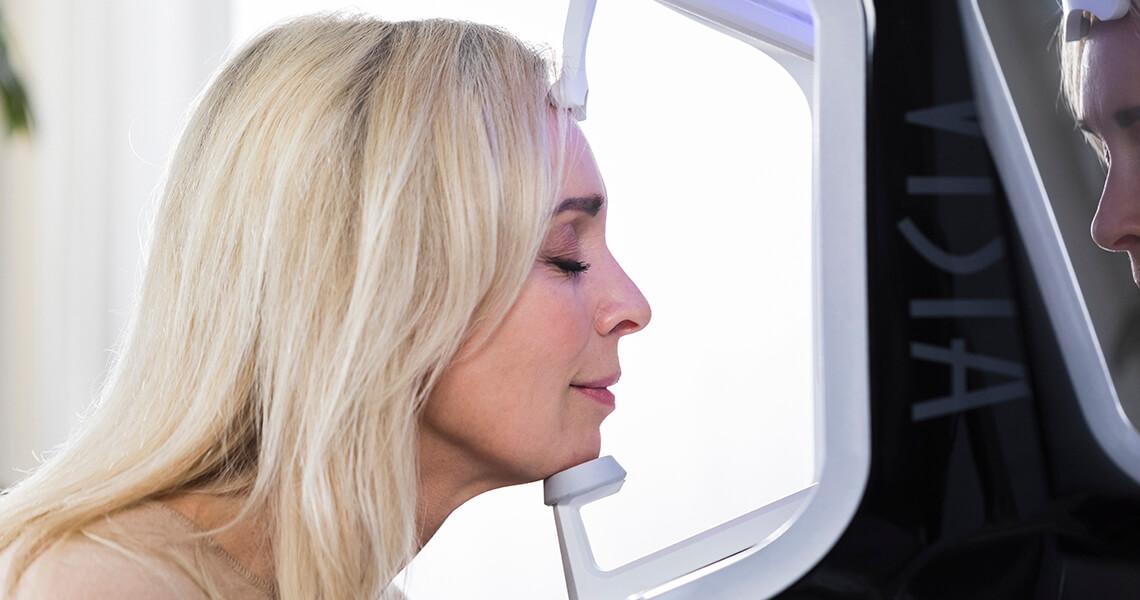 Woman scanning her skin